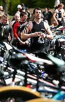 14 MAY 2010 - HOLME PIERREPONT, GBR - A competitor walks through transition before the start of the VUE National Emergency Services Triathlon Championships (PHOTO (C) NIGEL FARROW)