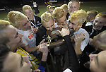 (Worcester Ma 111613) Belchertown sinks their teeth into the state trophy,  celebrating theri overtime win, during the MIAA Division Three Boys Soccer Final between Belchertown High and Medway High, Saturday night at Foley Field in Worcester. (Jim Michaud Photo) For Sunday