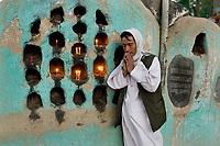 Man praying at Zeyarat-e-Sakhi tomb.