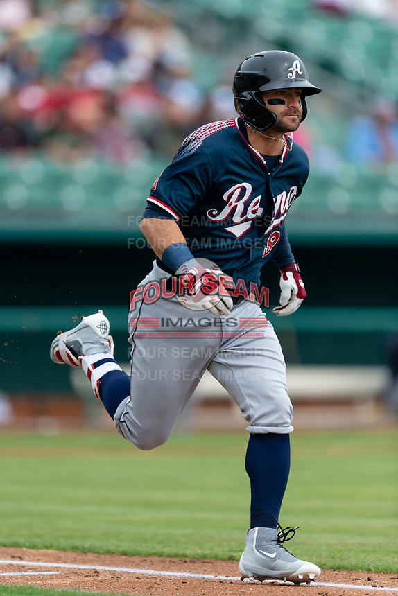 Reno Aces Andrew Aplin (9) hustles down the first base line during a game against the Fresno Grizzlies at Chukchansi Park on April 8, 2019 in Fresno, California. Fresno defeated Reno 7-6. (Zachary Lucy/Four Seam Images)