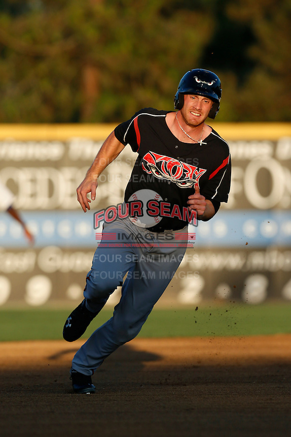 Kyle Gaedele #12 of the Lake Elsinore Storm runs the bases during a game against the Rancho Cucamonga Quakes at LoanMart Field on August 6, 2013 in Rancho Cucamonga, California. Lake Elsinore defeated Rancho Cucamonga, 13-5. (Larry Goren/Four Seam Images)