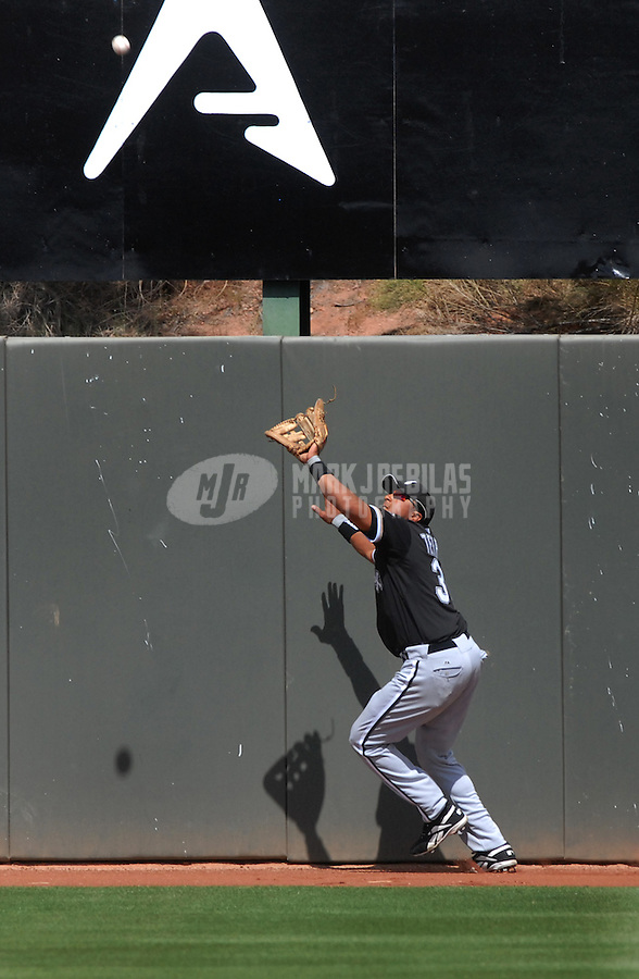 Mar 20, 2007; Phoenix, AZ, USA; Chicago White Sox center fielder (30) Luis Terrero catches a fly ball against the Oakland Athletics at Phoenix Municipal Stadium in Phoenix, AZ. Mandatory Credit: Mark J. Rebilas