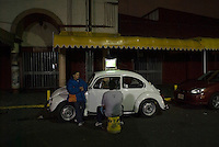 Fans watch a football game on the roof of a VW bug. Night bicycle riding with Mike smith and Kurt Holander.Mexico City, May 27, 2007