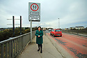 Marie Brown, Women's Aid, Northern Ireland, stands on the Lifford Bridge connecting Lifford, County Donegal in the Irish Republic with Strabane in County Tyrone,  Northern Ireland, Feb 22, 2019.  Photo/Paul McErlane