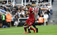 Liverpool's Georginio Wijnaldum battles with Newcastle United's Ayoze Perez<br /> <br /> Photographer Rich Linley/CameraSport<br /> <br /> The Premier League -  Newcastle United v Liverpool - Sunday 1st October 2017 - St James' Park - Newcastle<br /> <br /> World Copyright &copy; 2017 CameraSport. All rights reserved. 43 Linden Ave. Countesthorpe. Leicester. England. LE8 5PG - Tel: +44 (0) 116 277 4147 - admin@camerasport.com - www.camerasport.com