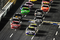 Oct. 17, 2009; Concord, NC, USA; NASCAR Sprint Cup Series driver Jimmie Johnson (48) leads the field during the NASCAR Banking 500 at Lowes Motor Speedway. Mandatory Credit: Mark J. Rebilas-