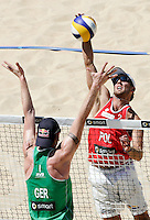 Campionati mondiali di beach volley, Roma, 18 giugno 2011..Germany's Julius Brink, back to camera, walls against Poland's Grzegorz Fijalek, during the Beach Volleyball World Championship in Rome, 18 june 2011..UPDATE IMAGES PRESS/Riccardo De Luca
