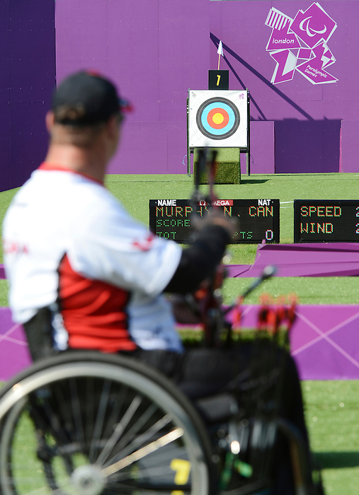 LONDON, ENGLAND 09/03/2012:  Norbert Murphy competing in the Men's Ind. Compound - W1 Semifinal at the London 2012 Paralympic Games at the Royal Artillery Barracks. (Photo by Matthew Murnaghan/Canadian Paralympic Committee)