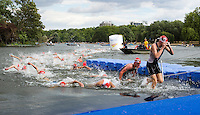 25 JUL 2010 - LONDON, GBR - Competitors leave the water after completing the first swim lap during the elite mens race of the London round of the ITU World Championship Series triathlon .(PHOTO (C) NIGEL FARROW)