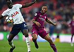 Raheem Sterling of Manchester City is challenged by Davinson Sanchez of Tottenham Hotspur during the premier league match at the Wembley Stadium, London. Picture date 14th April 2018. Picture credit should read: Robin Parker/Sportimage