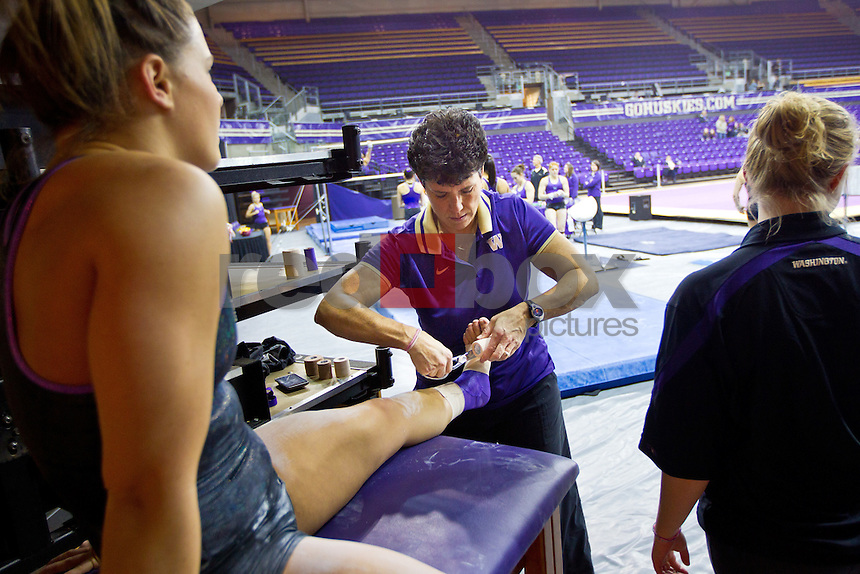 Lauren Rogers - Kathy Thompson - Athletic Trainer - The University of Washington gymnastics team competes in their annual intrasquad meet at Alaska Airlines Arena Saturday, Dec. 11, 2011. (Photography by Andy Rogers/Red Box Pictures)