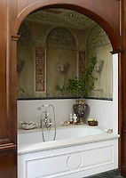 The mahogany-framed bath alcove has been hand-painted with a Florentine-inspired mural