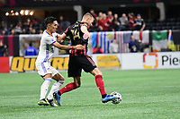 ATLANTA, GA - MARCH 07: ATLANTA, GA - MARCH 07: Atlanta United forward Adam Jahn dribbles the ball against Yuya Kubo during the match against FC Cincinnati, which Atlanta won, 2-1, in front of a crowd of 69,301 at Mercedes-Benz Stadium during a game between FC Cincinnati and Atlanta United FC at Mercedes-Benz Stadium on March 07, 2020 in Atlanta, Georgia.