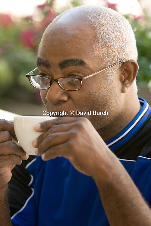 African American man drinking coffee