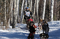 Anna Bertington runs down the trail after leaving the start during the Restart of the 2016 Iditarod in Willow, Alaska.  March 06, 2016.