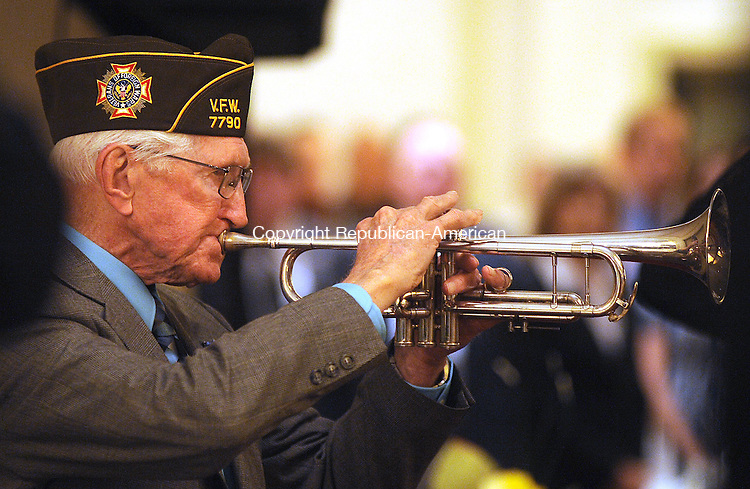 WATEBRURY, CT-23 MAY 2012--052312JS16-Al Jurus, a WWII Veteran and member of V.F.W. Post 7790 in Waterbury, plays Taps during the Support Our Troops dinner Wednesday at the CoCo Key Resort in Waterbury. The event was the first of many planned this Memorial Day Week by the Waterbury Veterans Memorial Committee. . Jim Shannon Republican-American