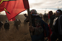 Protestors push back against riot police, who were using pepper spray, rubber bullets and tasers outside a Dakota Access Pipeline worker camp in Mandan, North Dakota on Tuesday, November 15, 2016. Protestors were drawing attention to the disproportionate sexual violence against indigenous women that is exacerbated by usually all male work crews.