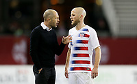 TORONTO, ON - OCTOBER 15: Gregg Berhalter and Michael Bradley #4 of the United States have a few words with each other during a game between Canada and USMNT at BMO Field on October 15, 2019 in Toronto, Canada.