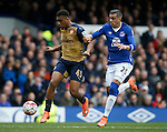 Alex Iwobi of Arsenal holds off Ramiro Funes Mori of Everton before scoring during the Barclays Premier League match at The Goodison Park Stadium. Photo credit should read: Simon Bellis/Sportimage