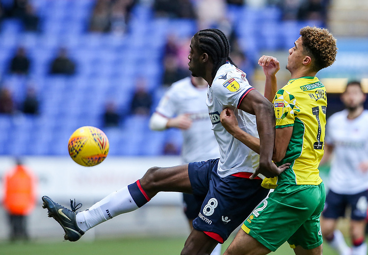 Bolton Wanderers' Clayton Donaldson competing with Norwich City's Jamal Lewis  <br /> <br /> Photographer Andrew Kearns/CameraSport<br /> <br /> The EFL Sky Bet Championship - Bolton Wanderers v Norwich City - Saturday 16th February 2019 - University of Bolton Stadium - Bolton<br /> <br /> World Copyright © 2019 CameraSport. All rights reserved. 43 Linden Ave. Countesthorpe. Leicester. England. LE8 5PG - Tel: +44 (0) 116 277 4147 - admin@camerasport.com - www.camerasport.com