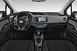 Stock photo of straight dashboard view of a 2015 Toyota Yaris Hybride Lounge 5 Door Hatchback 2WD Dashboard