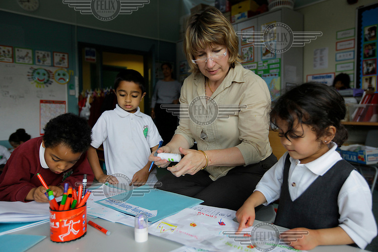 Teacher and Hindu convert, Mrs Clark with pupils in a class at the Krishna-Avanti primary school in Harrow, North London, the first state-funded Hindu faith school in Britain..