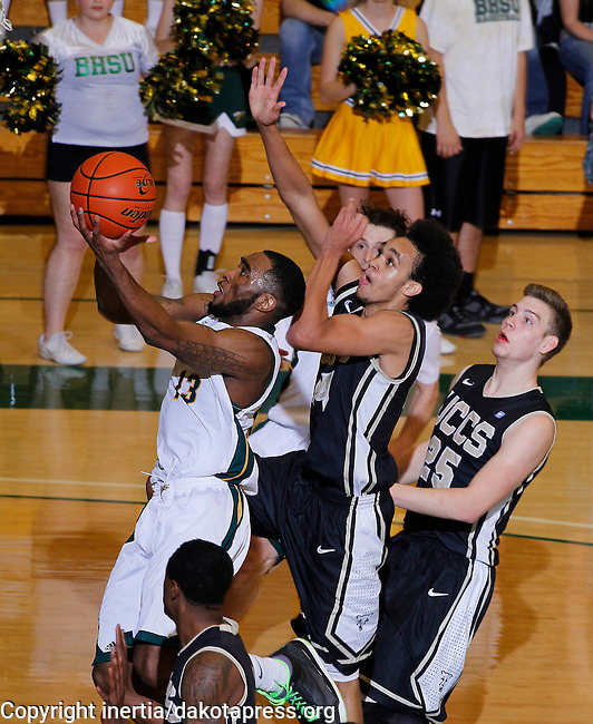 SPEARFISH, SD - FEBRUARY 22, 2014:  Myles Henry #13 of Black Hills State gets a layup past UC-Colorado Springs defenders Derrick White #14 and Alex Welsh #25 during their Rocky Mountain Athletic Conference game Saturday evening at the Donald E. Young Center in Spearfish, S.D.  (Photo by Dick Carlson/Inertia)