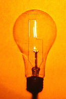 Illuminated lightbulb with grainy warm tones