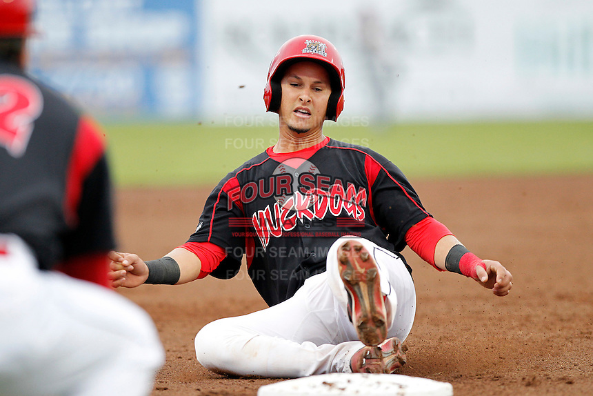 Batavia Muckdogs catcher Juan Castillo #35 slides safely into third during a game against the Mahoning Valley Scrappers at Dwyer Stadium on August 20, 2011 in Batavia, New York.  Batavia defeated Mahoning Valley 5-4.  (Mike Janes/Four Seam Images)