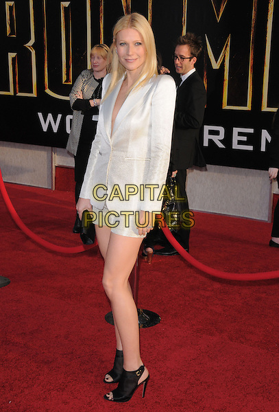 GWYNETH PALTROW.The Marvel World Premiere of Iron Man 2 held at The El Capitan Theatre in Hollywood, California, USA..April 26th, 2010      .full length white Giorgio Armani degrade shorts shiny jacket blazer ankle boots booties shooboots shoes black clutch bag open toe mesh shoulder pads .CAP/RKE/DVS.©DVS/RockinExposures/Capital Pictures.