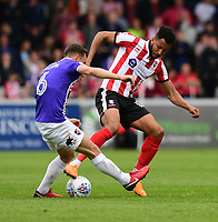 Lincoln City's Matt Green vies for possession with Exeter City's Jordan Tillson<br /> <br /> Photographer Chris Vaughan/CameraSport<br /> <br /> The EFL Sky Bet League Two Play Off First Leg - Lincoln City v Exeter City - Saturday 12th May 2018 - Sincil Bank - Lincoln<br /> <br /> World Copyright &copy; 2018 CameraSport. All rights reserved. 43 Linden Ave. Countesthorpe. Leicester. England. LE8 5PG - Tel: +44 (0) 116 277 4147 - admin@camerasport.com - www.camerasport.com