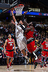 Devin Thomas (2) of the Wake Forest Demon Deacons drives to the basket past Montrezl Harrell (24) of the Louisville Cardinals during first half action at the LJVM Coliseum on January 4, 2015 in Winston-Salem, North Carolina.  The Cardinals defeated the Demon Deacons 85-76.  (Brian Westerholt/Sports On Film)