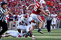 10 Sept 2011: Robbie Rouse #8 of the Fresno State Bulldogs gets around Baker Steinkuhler #55 of the Nebraska Cornhuskers in the first quarter at Memorial Stadium in Lincoln, Nebraska. Nebraska defeated Fresno State 42 to 29.