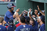 Infielder Fernando De Los Santos (1) of the Rome Braves, left, is congratulated after scoring a run in a game against the Greenville Drive on May 6, 2012, at Fluor Field at the West End in Greenville, South Carolina. Greenville won, 11-3. (Tom Priddy/Four Seam Images)