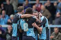 Teammates celebrate with goal scorer Michael Harriman of Wycombe as he scores his first goal during the Sky Bet League 2 match between Wycombe Wanderers and Hartlepool United at Adams Park, High Wycombe, England on 5 September 2015. Photo by Andy Rowland.