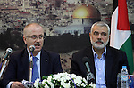 Palestinian Prime Minister Rami Hamdallah speaks during his meeting with senior Hamas leader Ismail Haniyeh, at Haniyeh's house in Gaza city on October 9, 2014. The Palestinian unity government which took the oath of office in June under technocrat prime minister Rami Hamdallah arrived to Gaza Strip on Thursday to convene the first fully meeting. Hamdallah said that the unity government will rebuild the bombed-out Gaza Strip following a seven-week Israeli offensive. Photo by Mohammed Asad