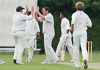 O Peck (R) congratulates A Ison on the wicket of B Choudhary - Upminster CC vs Gidea Park & Romford CC - Essex Cricket League at Upminster Park - 27/06/09- MANDATORY CREDIT: Gavin Ellis/TGSPHOTO - Self billing applies where appropriate - 0845 094 6026 - contact@tgsphoto.co.uk - NO UNPAID USE.