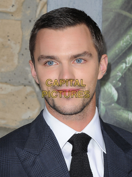 "Nicholas Hoult.""Jack The Giant Slayer"" Los Angeles Premiere held at Grauman's Chinese Theatre, Hollywood, California, USA..February 26th, 2013.headshot portrait black blue tie shirt stubble facial hair check suit                      .CAP/RKE/DVS.©DVS/RockinExposures/Capital Pictures."