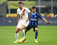 Calcio, Serie A: Inter Milano - AS Roma, Giuseppe Meazza stadium, December 6, 2019.<br /> Roma's Aleksandar Kolarov (l) in action with Inter's Matias Vecino (r) during the Italian Serie A football match between Inter and Roma at Giuseppe Meazza (San Siro) stadium, on December 6, 2019.<br /> UPDATE IMAGES PRESS/Isabella Bonotto