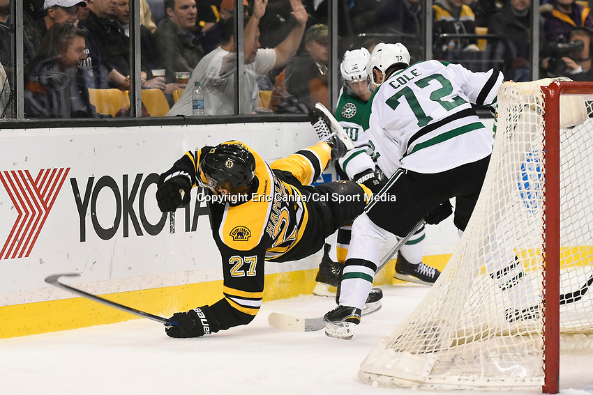 February 10, 2015 - Boston, Massachusetts, U.S. - Boston Bruins defenseman Dougie Hamilton (27) trips over Dallas Stars right wing Erik Cole (72) during the NHL match between the Dallas Stars and the Boston Bruins held at TD Garden in Boston Massachusetts. Dallas defeats Boston 5-3 in regulation time. Eric Canha/CSM