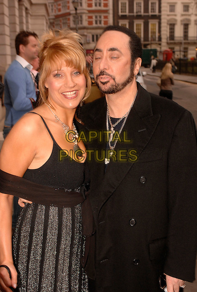 "MALANDRA BURROWS & DAVID GEST.""Grease Is The Word"" photocall, Bloomsbury Ballroom, Victoria House, London, UK..March 28th, 2007.half length black coat dress beard facial hair eyes closed funny face .CAP/FIN.©Steve Finn/Capital Pictures"