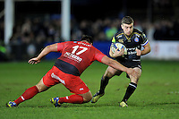 George Ford of Bath Rugby looks to get past Xavier Chiocci of Toulon. European Rugby Champions Cup match, between Bath Rugby and RC Toulon on January 23, 2016 at the Recreation Ground in Bath, England. Photo by: Patrick Khachfe / Onside Images