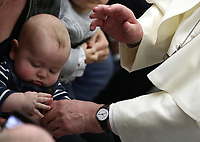 Un bambino tiene la mano di Papa Francesco al termine dell'udienza Generale del mercoledi' in aula Paolo VI in Vaticano, 9 gennaio 2019.<br /> A child holds Pope Francis hand at the end of the weekly general audience in Paul VI Hall at the Vatican, on January, 2019.<br /> UPDATE IMAGES PRESS/Isabella Bonotto<br /> <br /> STRICTLY ONLY FOR EDITORIAL USE