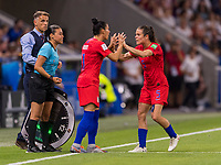 LYON,  - JULY 2: Ali Krieger #11 subs Kelley O'Hara #5 during a game between England and USWNT at Stade de Lyon on July 2, 2019 in Lyon, France.
