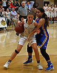 Thomaston, CT-121018MK01 Thomaston's Emma Kahn (1)  drives into tight defense from Gilbert's Marcela Moreira (12) Monday at Thomaston High School. Michael Kabelka / Republican-American