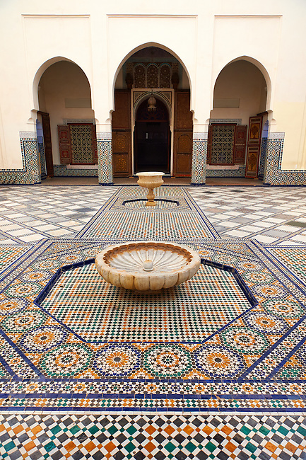 Berber Arabesque Morcabe plasterwok Zellige tiles of a fountain in the Marrakesh museum in the Dar Menebhi Palace, Marrakesh, Morocco