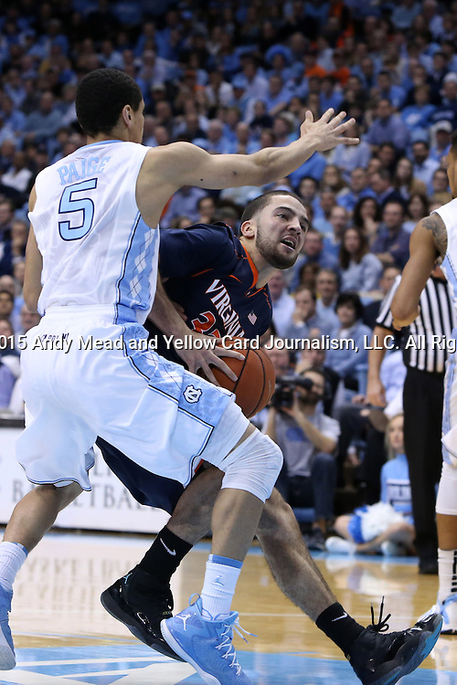 02 February 2015: Virginia's London Perrantes (right) and North Carolina's Marcus Paige (5). The University of North Carolina Tar Heels played the University of Virginia Cavaliers in an NCAA Division I Men's basketball game at the Dean E. Smith Center in Chapel Hill, North Carolina. Virginia won the game 75-64.