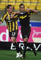 Phoenix' Troy Hearfield congratulates Leo Bertos for scoring the winning goal during the A-League football match between Wellington Phoenix and Perth Glory at Westpac Stadium, Wellington, New Zealand on Sunday, 16 August 2009. Photo: Dave Lintott / lintottphoto.co.nz