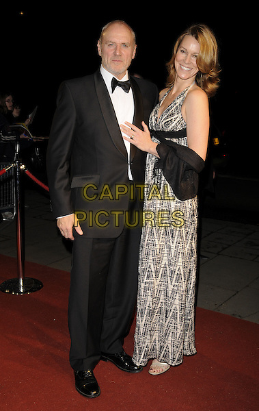 ALAN DALE & TRACEY PEARSON.The British Academy Television Awards 2008 after party held at the Grosvenor House Hotel,London, England..April 20th 2008. .BAFTA BAFTA's full length black suit bow tie white print patterned dress maxi Tracy married husband wife.CAP/CAN.©Can Nguyen/Capital Pictures.
