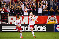 Dax McCarty (11) of the New York Red Bulls celebrates scoring with Connor Lade (16). The New York Red Bulls defeated the Columbus Crew 3-1 during a Major League Soccer (MLS) match at Red Bull Arena in Harrison, NJ, on September 15, 2012.